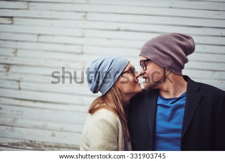 Romantic dates in stylish casualwear touching by their noses - stock photo