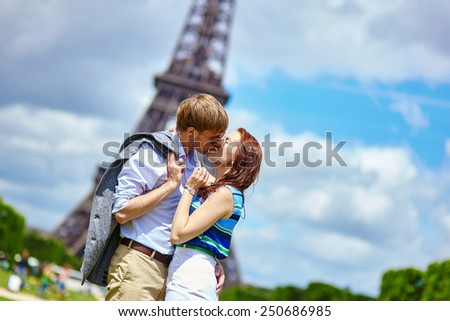 Romantic dating couple kissing in Paris near the Eiffel tower - stock photo