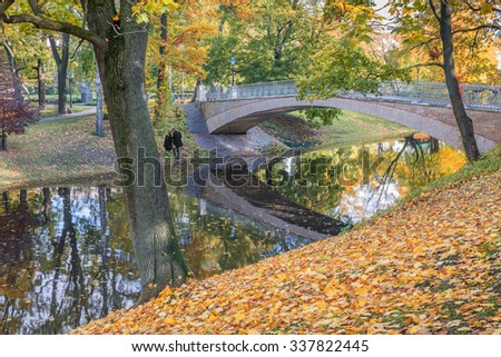 Romantic day in autumnal central park of Riga, Latvia - stock photo