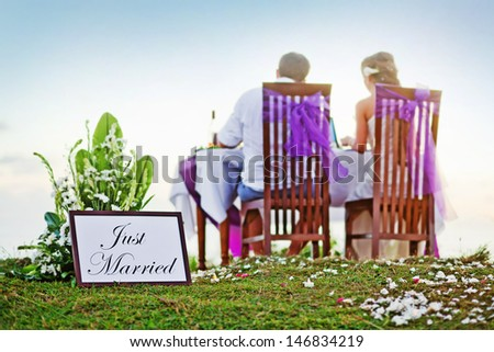 """romantic dinner - back view (soft focus on the """"just married"""" text) - stock photo"""