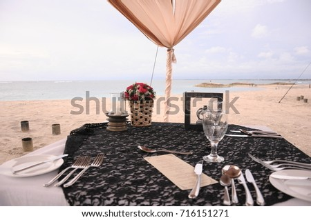 https://thumb7.shutterstock.com/display_pic_with_logo/167494286/716151271/stock-photo-romantic-dinner-by-bali-s-seaside-716151271.jpg