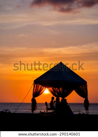 Romantic dinner on the beach in Bali - stock photo