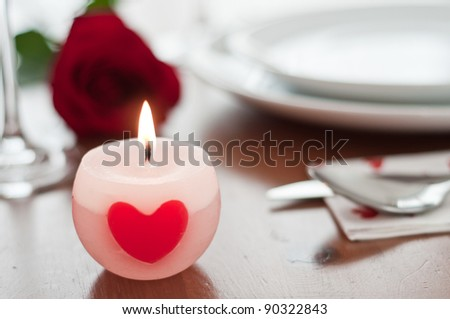 Romantic dinner setting with a rose and champagne glasses - stock photo