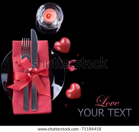 Romantic Dinner.Table place setting over black - stock photo