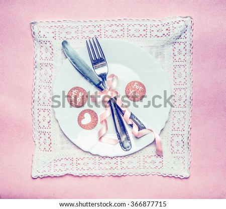 Romantic dinner table place setting with ribbon decoration and message cards on lace doily and pink background, top view. Retro color toned - stock photo