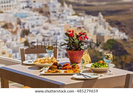 Romantic dinner with views of the mountains, Greece, Santorini