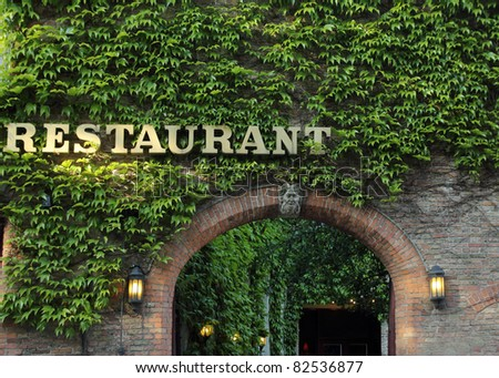 romantic entrance to old restaurant - stock photo