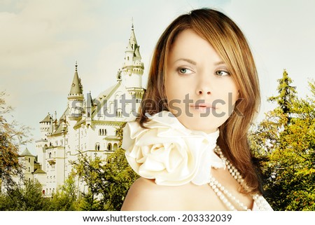 Romantic escape, beautiful young woman and fairytale castle - stock photo
