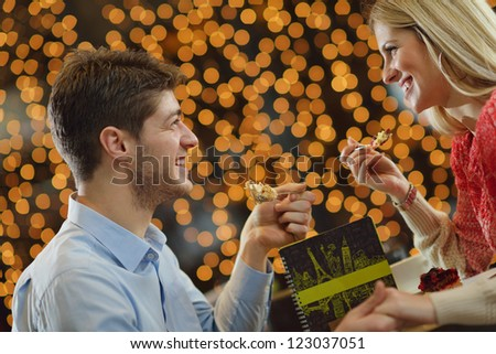 romantic evening date in hotel room, or supper in restaurant, happy couple with wine glass - stock photo