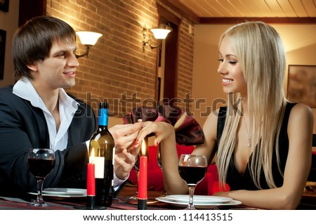 romantic evening date  in restaurant, happy couple,  guy propose marriage