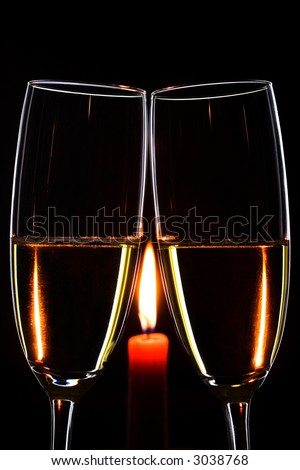 Romantic evening. Glasses. Champagne. Candle. Black background. Vertical - stock photo
