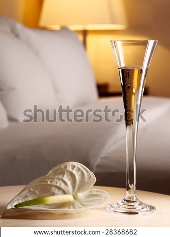 Romantic evening in an interior with a glass of a champagne - stock photo