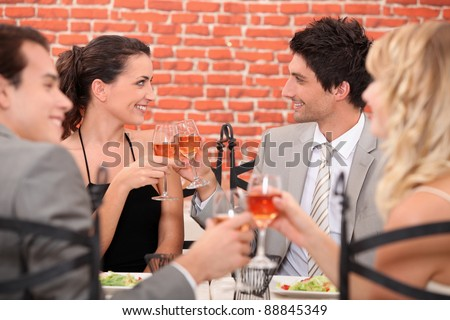 romantic foursome at restaurant - stock photo