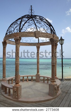 Romantic gazebo near the ocean in the Caribbean - stock photo