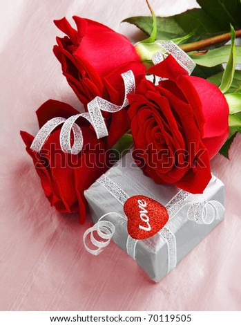 Romantic gift & red roses, isolated on pink background, love concept - stock photo