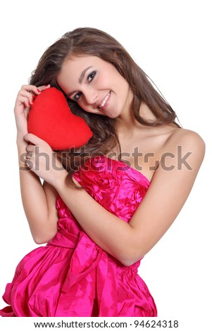 Romantic girl holding a love sign - stock photo