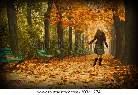 romantic girl in a park in autumn - stock photo