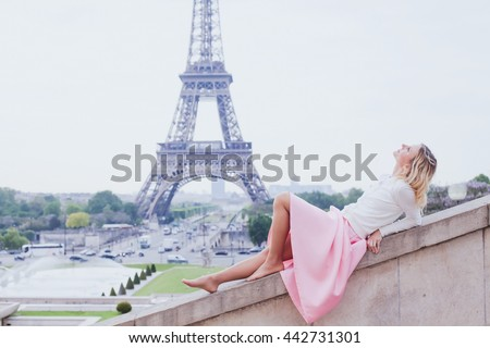 romantic girl in Paris, fashion woman looking up near Eiffel tower