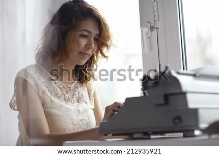 romantic girl is typing - stock photo