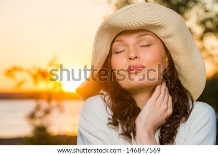 Romantic girl on the beach during sunset - stock photo