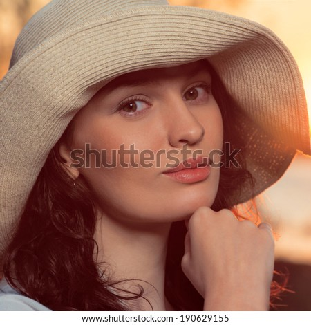Romantic girl on the beach during sunset. Vintage style photo - stock photo