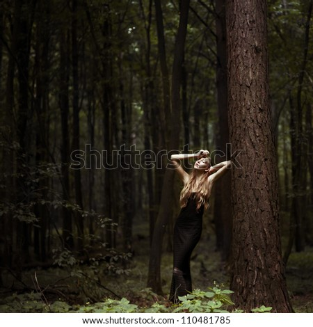 Romantic girl posing in the forest