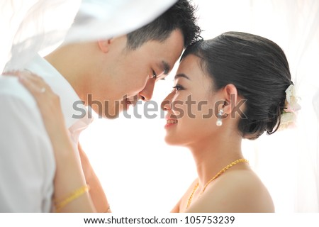Romantic groom and bride dancing in their wedding day - stock photo