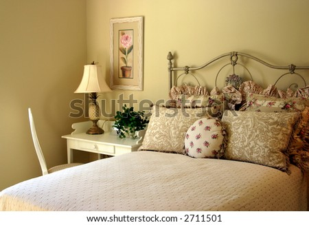 romantic guest bedroom with desk and chair - stock photo