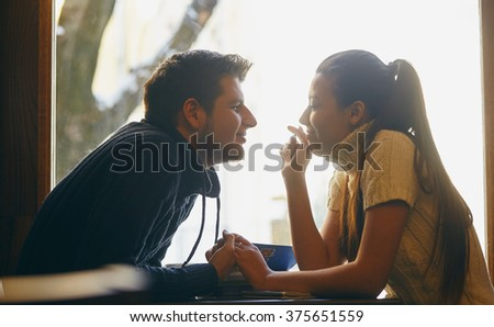 Romantic happy couple in the cafe. - stock photo