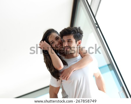 romantic happy young couple relax at modern home indoors and have fun - stock photo