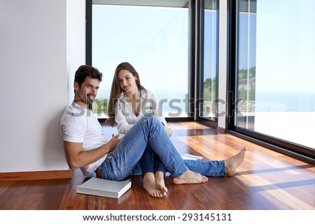 romantic happy young couple relax at modern home staircase indoors - stock photo