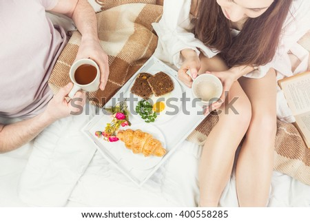 romantic healthy breakfast in bed young couple. top view. loving relationship