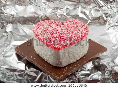 romantic heart-shaped cake with a cup of green tea and  grief white candl - stock photo