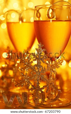 Romantic holiday drink, celebration of Christmas or new year eve, party with Champagne and festive gold ornament lights decoration - stock photo