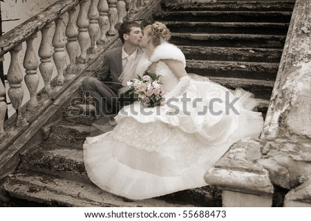 Romantic image of attractive couple. Smiling Newlywed Couple on Wedding Day. newly wed couple enjoy their time. Just married! - stock photo