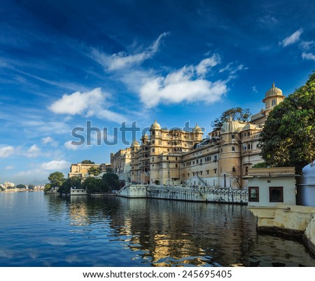 Romantic India luxury tourism concept background - Udaipur City Palace and Lake Pichola. Udaipur, Rajasthan, India - stock photo