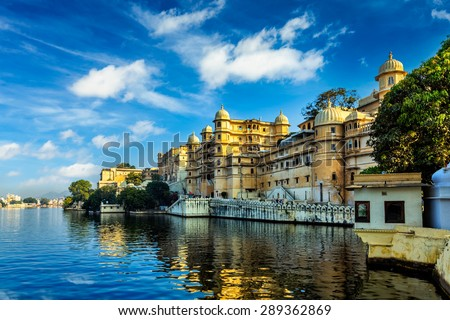 Romantic India luxury tourism wallpaper  - Udaipur City Palace and Lake Pichola. Udaipur, Rajasthan, India - stock photo