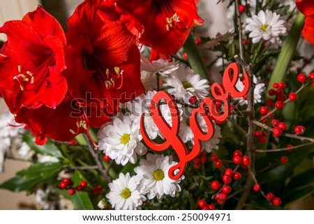 Romantic installation with bridal bouquet, for ST. Valentines Day with flowers and red wooden sign Love - stock photo