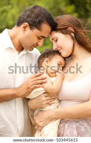 Romantic Intimate Portrait of Indian Father, Caucasian Mother and Baby Son - stock photo