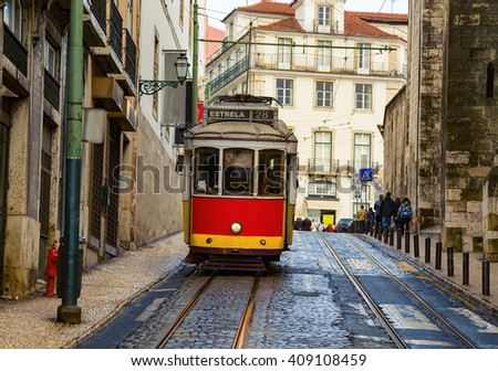 Romantic Lisbon street with the typical tram and Lisbon  - stock photo