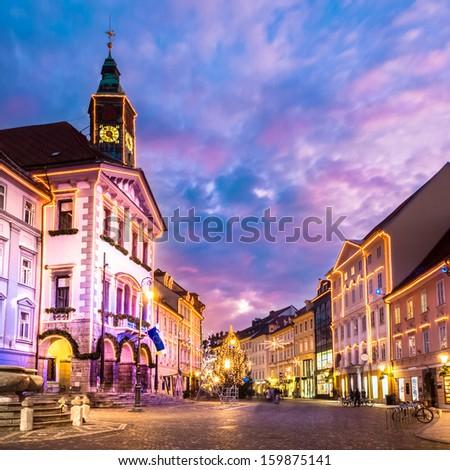 Romantic Ljubljana's city center, the capital of Slovenia, Europe. City hall and Roba's fountain shot at dusk. - stock photo