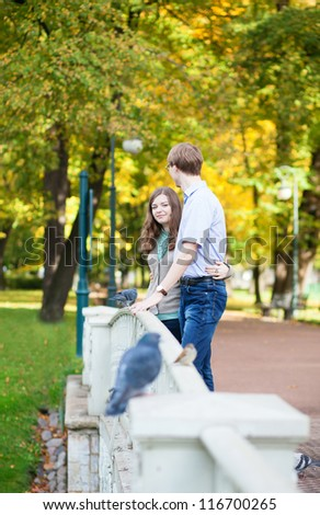Romantic loveing couple in park - stock photo