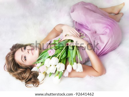 Romantic lovely young serene girl with bouquet of fresh tulips - Saint Valentine's Day ( 8 March )
