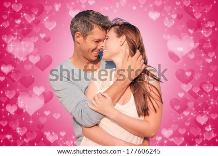 romantic lovers on red wall - stock photo