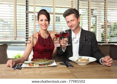 romantic lunch for two - couple in a restaurant - stock photo