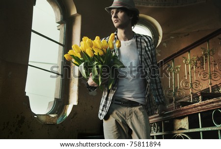 Romantic man holding bunch of tulips - stock photo