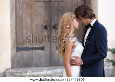 Romantic married couple holding each other with eyes closed. - stock photo
