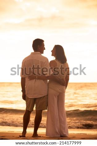 Romantic Mature Couple Enjoying at Sunset on the Beach in Hawaii - stock photo