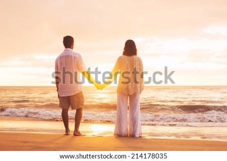 Romantic Mature Couple Enjoying Sunset at the Beach - stock photo
