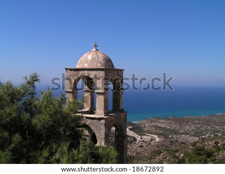 Romantic, mediterranean church tower. Kos Island, Dodecanese archipelago, Greece. - stock photo